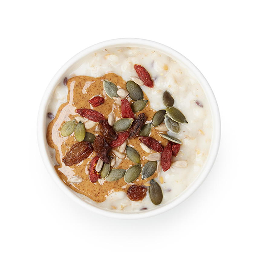 Coconut milk porridge with toasted seeds